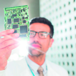 Engineer examining circuit board